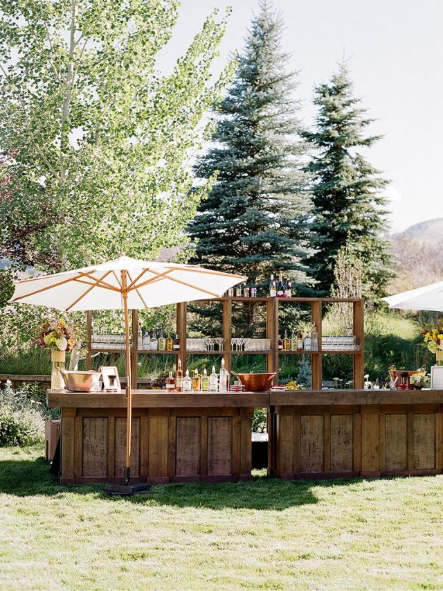 The bar is a spot that most of your guests will visit a few times throughout the night, which is precisely why it's a great place to add a burst of color or personalized décor element.