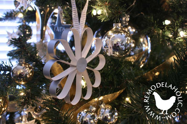 Simple Christmas Flower made of paper for an easy paper Christmas decoration at Remodelaholic.com