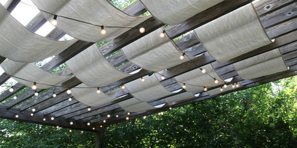 drop cloth sail pergola update with outdoor string lights