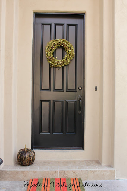 black entry door in Tricorn Black