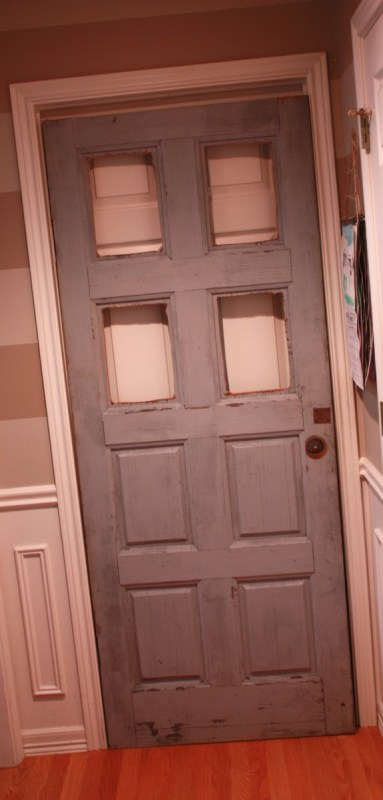 7 Thrifted door remade into rustic dutch door with glass panels by Its the Little Things featured on @Remodelaholic