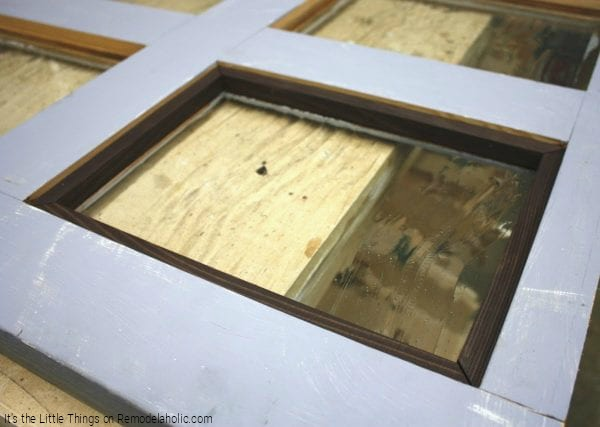 DIY Secure Backing For Glass Panels Added To Thrifted Door By Its The Little Things Featured On @Remodelaholic 600x427