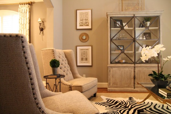 Designing-A-Living-Room-With-Tall-Walls-zebra-pattern-dyed-cow-hide (5)