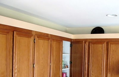 10 Create a staggered cabinet look using crown molding, by My Uncommon Slice of Suburbia featured on @Remodelaholic
