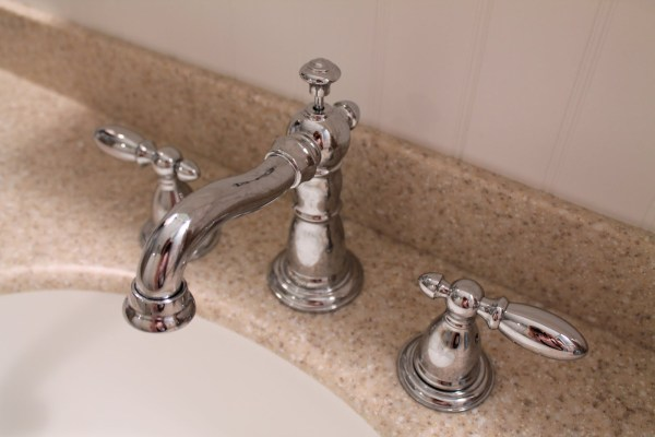 12 Delta faucets in bathroom remodel, by Elizabeth and Co featured on @Remodelaholic