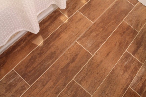 23 Wood tile is beautiful in this bathroom remodel, by Elizabeth and Co featured on @Remodelaholic