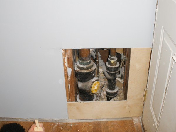 Hiding plumbing access with wainscoting-2