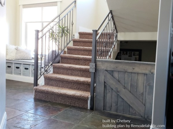 Wooden Barn Door Baby Gate Installed On A Metal Stair Banister, Built By Chelsey, Plans By Remodelaholic