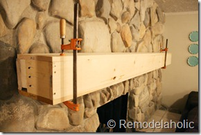 Installing a wood mantel on a stone wall (71)