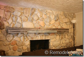Installing a wood mantel on a stone wall (79)