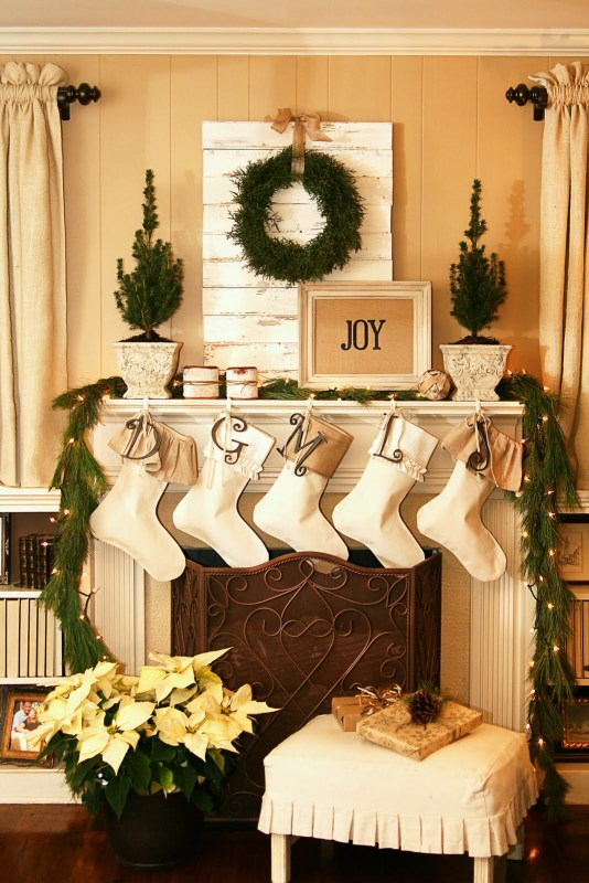 Holiday (or Christmas) mantel ideas, Fresh Greens and Burlap mantel by The Butlers