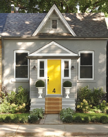 Yellow enrty door with grey exterior