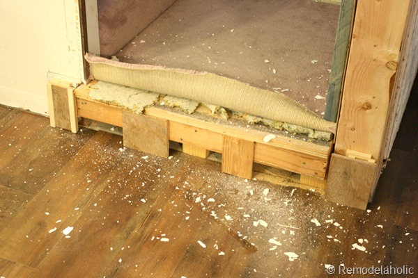 building out stair with wood bullnose and house numbers under barn door (1)