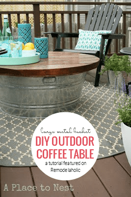 DIY Outdoor Coffee Table From A Large Metal Bucket By A Place To Nest Featured On Remodelaholic