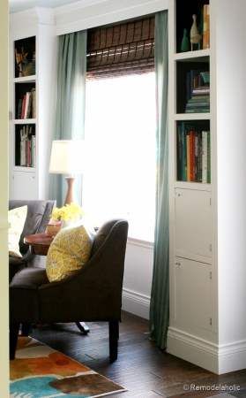 Living Room Remodel with yellow accents wood floors and built-in bookcases and columns with arches-12