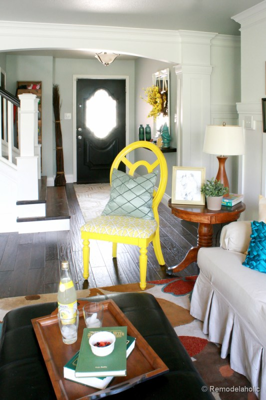 Living Room Remodel with yellow accents wood floors and built-in bookcases and columns with arches-20