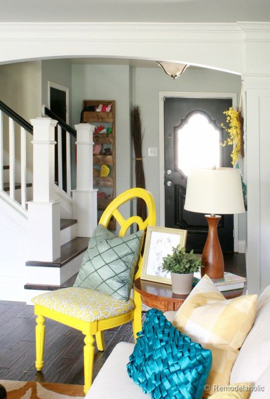 Living Room Remodel with yellow accents wood floors and built-in bookcases and columns with arches-27