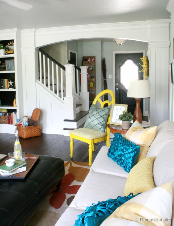 Living Room Remodel with yellow accents wood floors and built-in bookcases and columns with arches-28