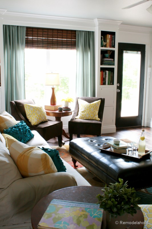 Living Room Remodel with yellow accents wood floors and built-in bookcases and columns with arches-38