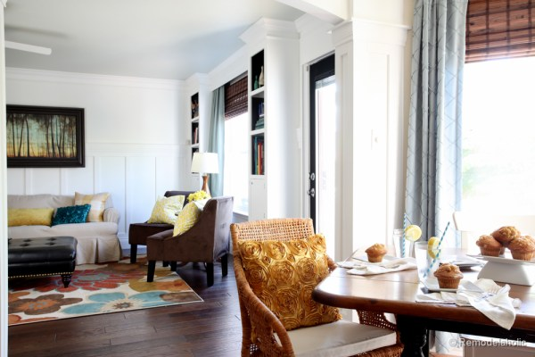 Living Room Remodel with yellow accents wood floors and built-in bookcases and columns with arches-4