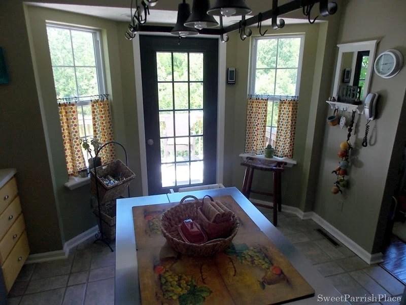 kitchen with painted subway tile backsplash