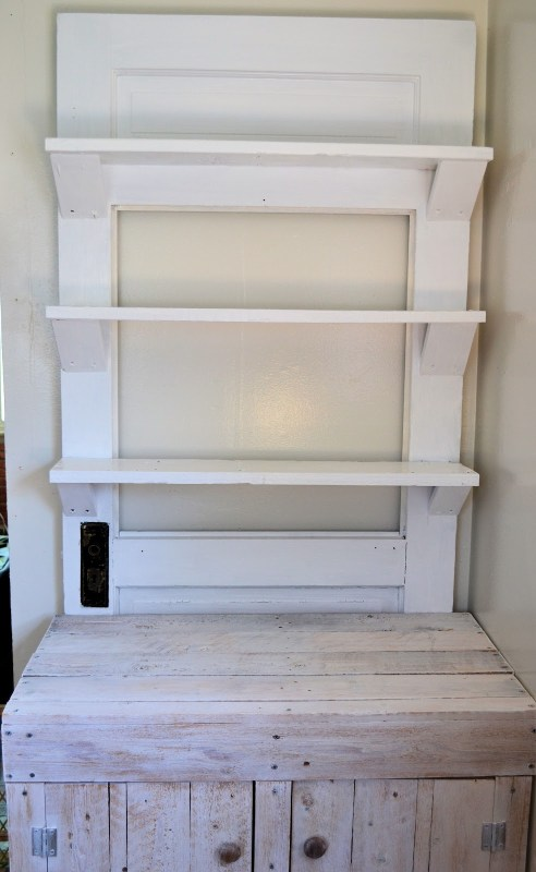 old door turned into shelf wall display