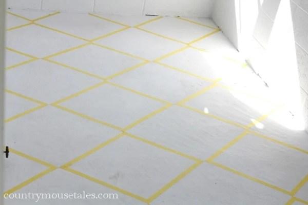 tape design to paint a concrete mudroom floor