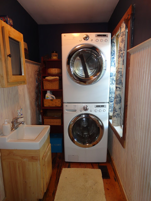 half bath and tiny laundry space with stacked washer and dryer, The Long Awaited Home