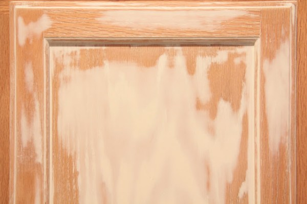 using brushing putty to cover wood grain before painting kitchen cabinets