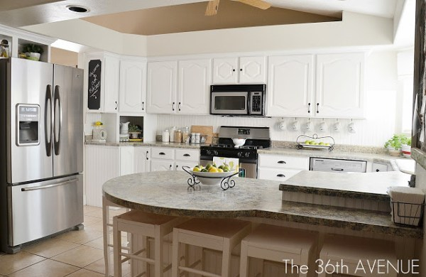 White Kitchen Remodel Using Thrifted Cabinets | Remodelaholic