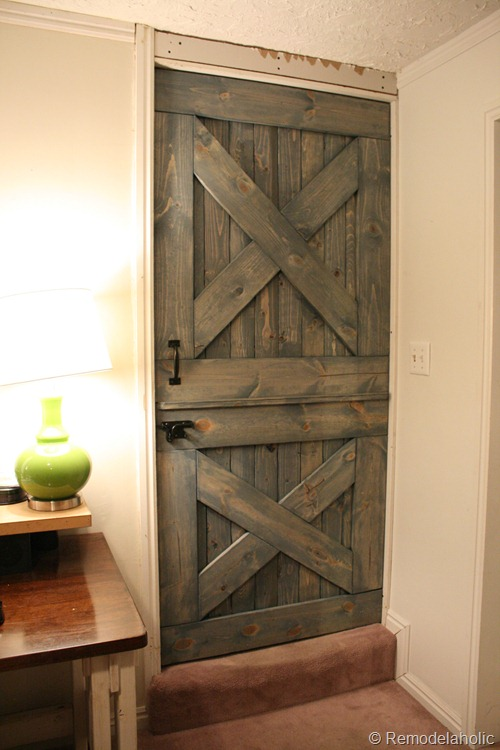 barn door inspired dutch door with baby gate, Remodelaholic