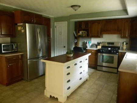 two toned kitchen cabinets with kitchen island. best kitchen remodel ideas -- secondhand craigslist kitchen remodel, Binkies and Briefcases on Remodelaholic