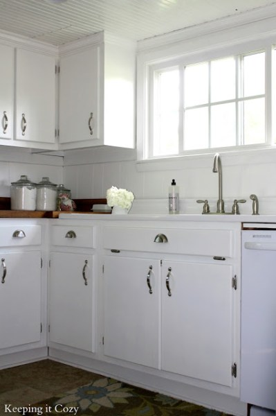 best kitchen remodel ideas -- white painted cabinets with reclaimed wood countertops, Keeping It Cozy on Remodelaholic