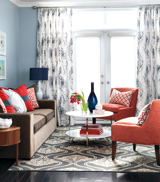 Colorful casual living room in coral and navy style at home