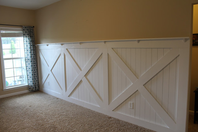 finished barn door wainscoting wall treatment with wall ledge topper