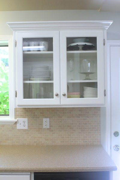 upgrade cabinets by adding glass, Everywhere Beautiful on Remodelaholic