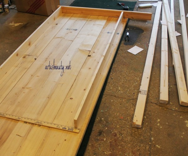 building a farmhouse table, featured on Remodelaholic.com