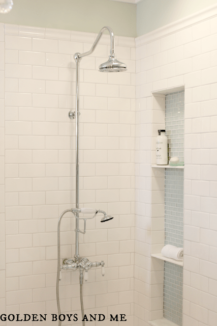 built-in shower niche in elegant master bath remodel, featured on Remodelaholic.com