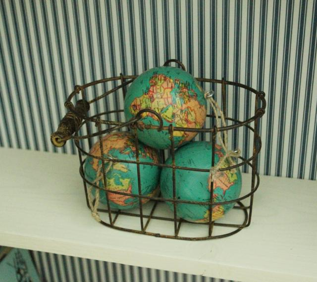 globe details of antique suitcase bookshelf, featured on Remodelaholic.com