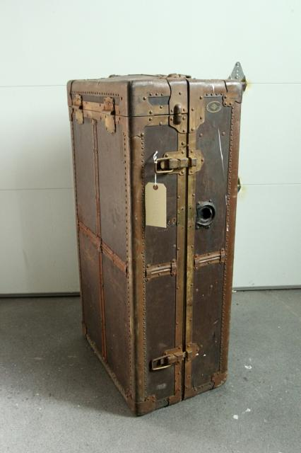 old trunk suitcase to be turned into a standing bookshelf, featured on Remodelaholic.com