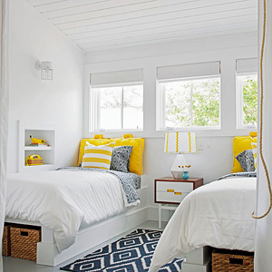 yellow and navy shared bedroom
