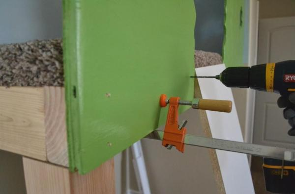 attaching walls to the indoor tree house enclosure, I Am Hardware featured on Remodelaholic