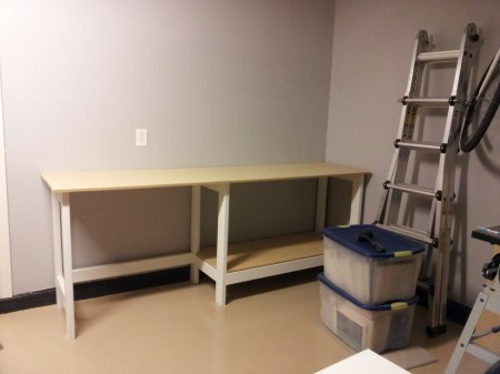 diy workbench with storage underneath, featured on Remodelaholic.com