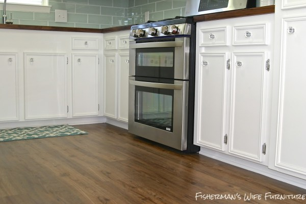 double oven in a white kitchen makeover, Fisherman's Wife Furniture featured on Remodelaholic.com