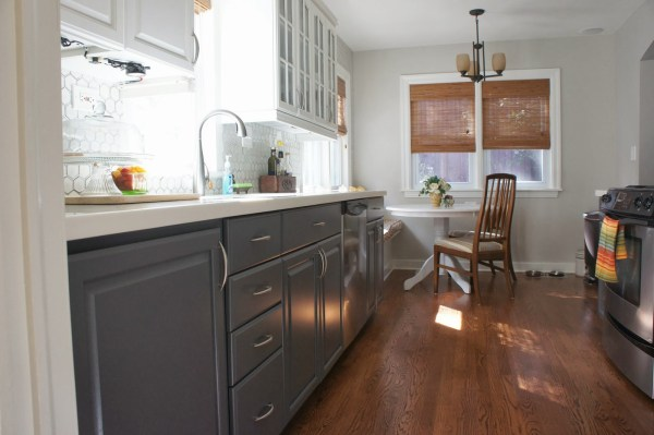 gray and white kitchen with breakfast nook banquette, LoveLee Homemaker featured on Remodelaholic
