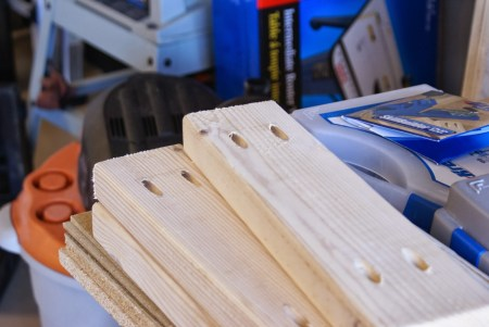 kreg-jig pocket holes to build workbench and pegboard tool cabinet, featured on Remodelaholic.com