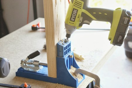 kreg-jig to build workbench and pegboard tool cabinet, featured on Remodelaholic.com