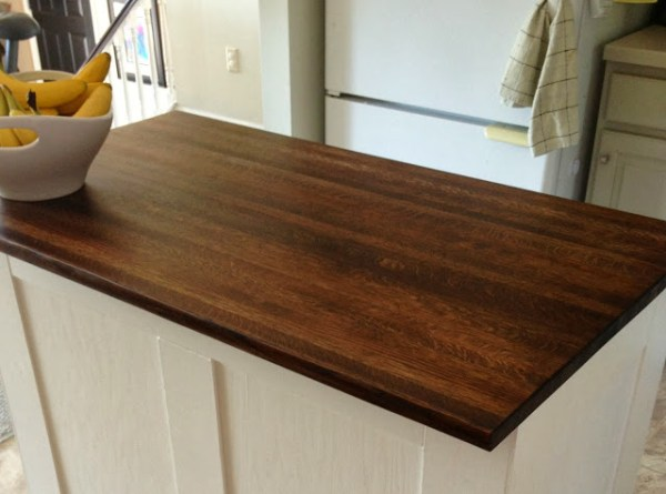 new butcher block top for the board and batten kitchen island, featured on Remodelaholic