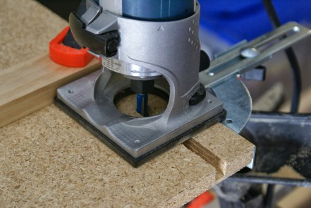 router to cut corners for workbench legs, featured on Remodelaholic.com