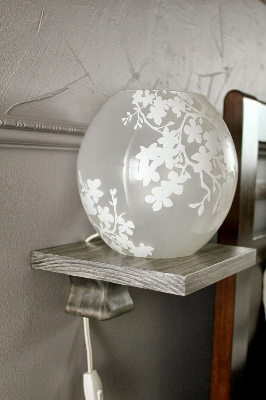 simple DIY bedside lamp shelf, Turtles and Tails featured on Remodelaholic